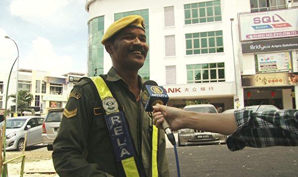 志願警衛隊隊員Yusni。(新唐人視頻截圖)