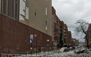 強風吹落大樓牆皮 十輛車受波及