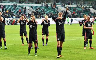 卫冕冠军拜仁慕尼黑在客场2-0战胜沃尔夫斯堡,以八分优势领跑积分榜。 (Stuart Franklin/Bongarts/Getty Images)