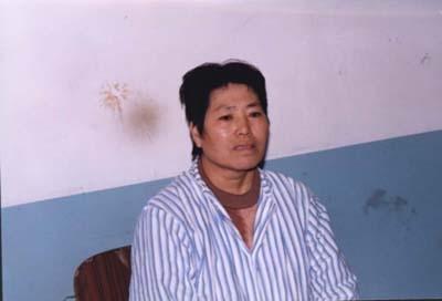 2001年的周润君,是个四十多岁的中年妇女,曾是毛纺厂的纺织女工。(明慧网)