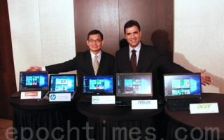 台湾微软消费通路事业群总经理吴胜雄(左)、微软OEM业务副总裁阿尔瓦罗‧赛利斯(Alvaro Celis)(右)。(陈懿胜/大纪元)