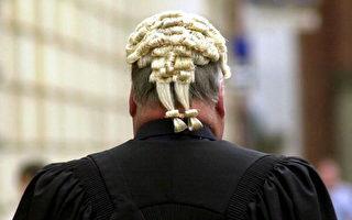 英国要价最高的律师每小时收费已经达到1,100镑。(NICOLAS ASFOURI/AFP/Getty Images)