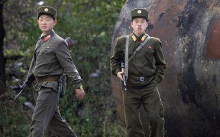 金正恩公開處決了今年4月朝鮮駐華餐廳員工集體投誠事件的6名責任人。(圖片來源:FREDERIC J. BROWN / AFP)