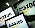 隨著亞馬遜持續擴張,售貨系統變得複雜,要在亞馬遜網站買到最便宜的貨,消費者得多花點功夫比價。(LEON NEAL/AFP/Getty Images)