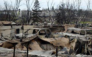 麦克默里堡山火肆虐,导致爆发加国史上最大的全城疏散,图为烧毁的住家,满目苍夷。(加通社)