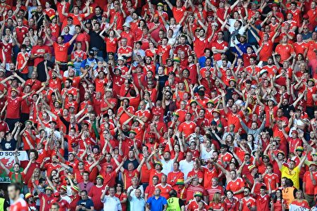 Wales' fans celebrate their team's victory during the Euro 2016 round of sixteen football match Wales vs Northern Ireland, on June 25, 2016 at the Parc des Princes stadium in Paris. / AFP / MIGUEL MEDINA (Photo credit should read MIGUEL MEDINA/AFP/Getty Images)