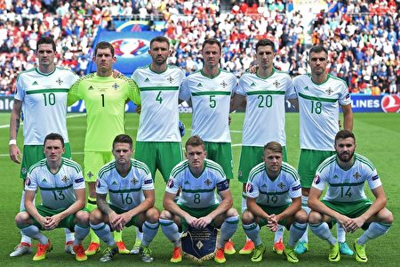 Northern Ireland's starting eleven pose for a group picture during the Euro 2016 round of sixteen football match Wales vs Northern Ireland, on June 25, 2016 at the Parc des Princes stadium in Paris. / AFP / PAUL ELLIS (Photo credit should read PAUL ELLIS/AFP/Getty Images)