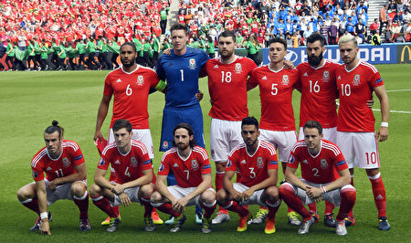 Back row from left : Wales' defender Ashley Williams, Wales' goalkeeper Wayne Hennessey, Wales' forward Sam Vokes, Wales' defender James Chester, Wales' midfielder Joe Ledley, Wales' midfielder Aaron Ramsey and bottom row from left : Wales' forward Gareth Bale, Wales' defender Ben Davies, Wales' midfielder Joe Allen, Wales' defender Neil Taylor, Wales' defender Chris Gunter pose for a group photo during the Euro 2016 round of sixteen football match Wales vs Northern Ireland, on June 25, 2016 at the Parc des Princes stadium in Paris. / AFP / DAMIEN MEYER (Photo credit should read DAMIEN MEYER/AFP/Getty Images)