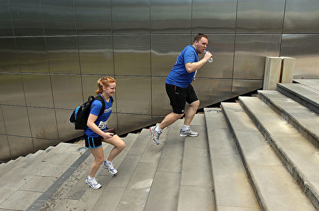 SYDNEY, AUSTRALIA - NOVEMBER 20: A team runs up a staircase during the 2010 Urban Max Series adventure race in the city on November 20, 2010 in Sydney, Australia. Participants competed in pairs of two and were challenged to reach predetermined checkpoints by solving riddles using only using only a mobile phone, map and cue sheet. Contestants could walk, run or take public transport but the use of cars, bikes or taxis meant instant disqualification. (Photo by Cameron Spencer/Getty Images)