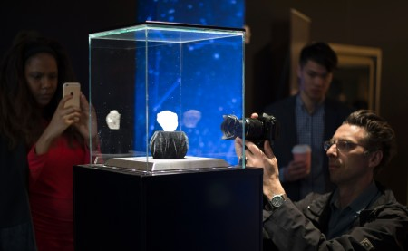 Members of the press take photos of the 1109-carat LESEDI LA RONA diamond displayed May 4, 2016 at Sotheby's in New York. The rough diamond, uncovered in Botswana, southern Africa, last year estimated to be three billion years old, will be offered in a stand-alone auction in London on June 29, 2016, estimated to sell for in excess of $70 million USD. / AFP / DON EMMERT (Photo credit should read DON EMMERT/AFP/Getty Images)