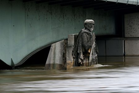 This picture taken on June 3, 2016 shows the Zouave statue of the Alma bridge flooded by the river Seine following heavy rainfalls in Paris. Paris' Louvre and Orsay museums shut on June 3 to remove art treasures from their basements as the swollen River Seine neared its highest level in three decades. At least 16 people have been killed in floods that have wrought havoc in parts of Europe after days of pounding rain, trapping people in their homes and forcing rescuers to row lifeboats down streets turned into rivers. / AFP / Bertrand GUAY (Photo credit should read BERTRAND GUAY/AFP/Getty Images)