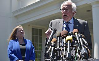 6月9日民主党总统参选人桑德斯在白宫与奥巴马总统会面后,举行新闻会。他没有表示将退出大选。后侧站立者是桑德斯的太太。(MANDEL NGAN/AFP/Getty Images)