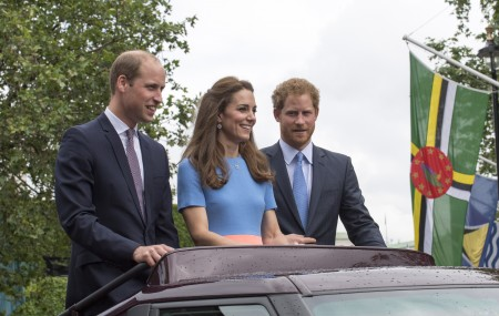 "LONDON, ENGLAND - JUNE 12: Prince William, Duke of Cambridge, Catherine, Duchess of Cambridge and Prince Harry, ride in an open top Range Rover as they greet guests attending ""The Patron's Lunch"" celebrations for The Queen's 90th birthday on The Mall on June 12, 2016 in London, England. 10,000 guests have gathered on The Mall for a lunch to celebrate The Queen's Patronage of more than 600 charities and organisations. The lunch is part of a weekend of celebrations marking Queen Elizabeth II's 90th birthday and 63 year reign. The Duke of Edinburgh and other members of The Royal Family are also in attendance. During the lunch a carnival parade will travel down The Mall and around St James's Park. (Photo by Arthur Edwards - WPA Pool/Getty Images)"