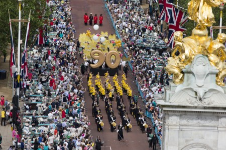 "LONDON, ENGLAND - JUNE 12: A general view of the parade during ""The Patron's Lunch"" celebrations for The Queen's 90th birthday on The Mall on June 12, 2016 in London, England. 10,000 guests have gathered on The Mall for a lunch to celebrate The Queen's Patronage of more than 600 charities and organisations. The lunch is part of a weekend of celebrations marking Queen Elizabeth II's 90th birthday and 63 year reign. The Duke of Edinburgh and other members of The Royal Family are also in attendance. During the lunch a carnival parade will travel down The Mall and around St James's Park. (Photo by Ian Vogler - WPA Pool/Getty Images)"