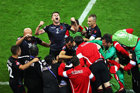 LYON, FRANCE - JUNE 19:  Andi Lila of Albania celebrates his team's first goal scored by Armando Sadiku (obscured) with his team mates during the UEFA EURO 2016 Group A match between Romania and Albania at Stade des Lumieres on June 19, 2016 in Lyon, France.  (Photo by Julian Finney/Getty Images)