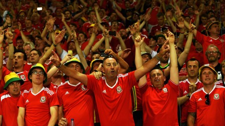 TOULOUSE, FRANCE - JUNE 20: Wales supporters celebrate after their team's third goal during the UEFA EURO 2016 Group B match between Russia and Wales at Stadium Municipal on June 20, 2016 in Toulouse, France. (Photo by Dennis Grombkowski/Getty Images)