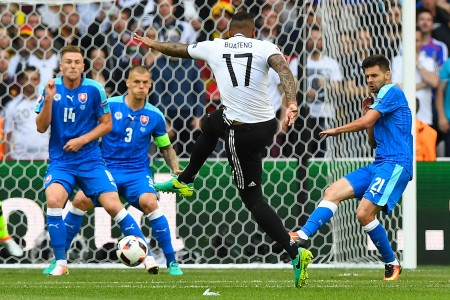 Germany's defender Jerome Boateng kicks the ball to score a goal during the Euro 2016 round of 16 football match between Germany and Slovakia at the Pierre-Mauroy stadium in Villeneuve-d'Ascq near Lille on June 26, 2016. / AFP / Joe KLAMAR (Photo credit should read JOE KLAMAR/AFP/Getty Images)