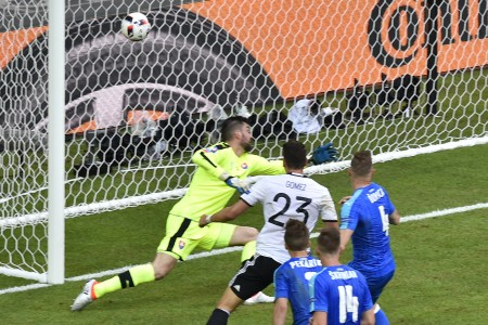 Germany's forward Mario Gomez (C) scores against Slovakia's goalkeeper Matus Kozacik during the Euro 2016 round of 16 football match between Germany and Slovakia at the Pierre-Mauroy stadium in Villeneuve-d'Ascq, near Lille, on June 26, 2016. / AFP / DENIS CHARLET (Photo credit should read DENIS CHARLET/AFP/Getty Images)