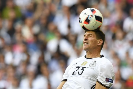 Germany's forward Mario Gomez heads the ball during the Euro 2016 round of 16 football match between Germany and Slovakia at the Pierre-Mauroy stadium in Villeneuve-d'Ascq near Lille on June 26, 2016. / AFP / Joe KLAMAR (Photo credit should read JOE KLAMAR/AFP/Getty Images)
