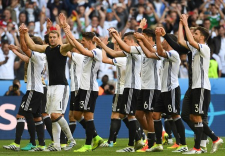 Germany's players celebrate at the end of the Euro 2016 round of 16 football match between Germany and Slovakia at the Pierre-Mauroy stadium in Villeneuve-d'Ascq near Lille on June 26, 2016. / AFP / PATRIK STOLLARZ (Photo credit should read PATRIK STOLLARZ/AFP/Getty Images)