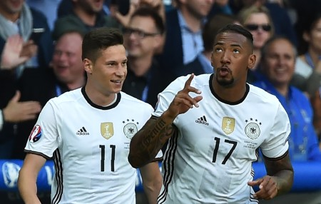 Germany's defender Jerome Boateng (R) celebrates with Germany's midfielder Julian Draxler after scoring during the Euro 2016 round of 16 football match between Germany and Slovakia at the Pierre-Mauroy stadium in Villeneuve-d'Ascq, near Lille, on June 26, 2016. / AFP / PHILIPPE HUGUEN (Photo credit should read PHILIPPE HUGUEN/AFP/Getty Images)