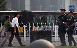 6月27日,習近平在深改會上喊出「動真刀真槍」後,同日安徽慶市公安局長落馬。圖為,北京街頭。  (Photo by Feng Li/Getty Images)