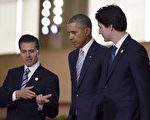 本周三,北美三友峰会将于渥太华举行。图为三国领导人去年11月在菲律宾马尼拉的亚太经合组织峰会上。(加通社)
