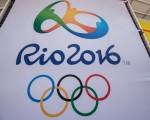 美国《体育画报》在最新一期刊发里约热内卢奥运会奖牌预测的专题报导。预计奖牌排行榜,美国、中国及俄国仍居世界前三3名。(YASUYOSHI CHIBA/AFP/Getty Images)