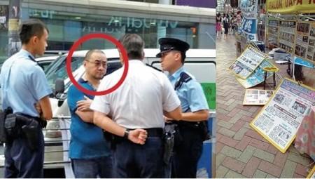 一名身穿藍色上衣的中年男子星期二多次搗毀位於旺角亞皆老街的法輪功真相點,在法輪功學員及警方的合力追逐下,該男子最終被拘捕。(大紀元)