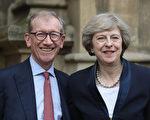 """英国新首相梅对于大洋彼岸的美国来说,还是一个""""陌生人""""。图为梅和丈夫飞利浦。(Christopher Furlong/Getty Images)"""