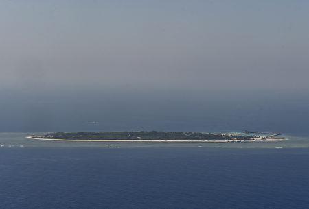 南海仲裁结果今天公布,国安高层密切关注,多次沙盘推演相关因应作为。图为太平岛。(AFP)