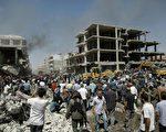 7月28日,敘利亞北部庫爾德族居民為主的卡米什利市(Qamishli)遭到規模巨大的「雙轟炸」攻擊。(AFP)