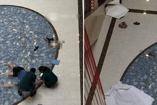 父亲抱着儿子稳稳地站在扶梯上,突然翻过扶手双双坠地身亡。(网络图片)