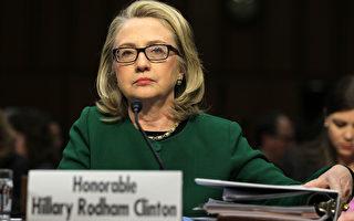 1月23日希拉里就之前美国驻利比亚外交官遭袭身亡事件,在参议院接受听证。(Alex Wong/Getty Images)