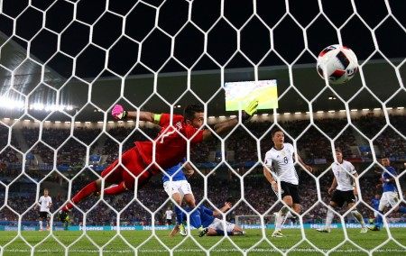 BORDEAUX, FRANCE - JULY 02: Gianluigi Buffon of Italy dives in vain as Mesut Oezil of Germany scores the oepning goal during the UEFA EURO 2016 quarter final match between Germany and Italy at Stade Matmut Atlantique on July 2, 2016 in Bordeaux, France. (Photo by Alex Livesey/Getty Images)