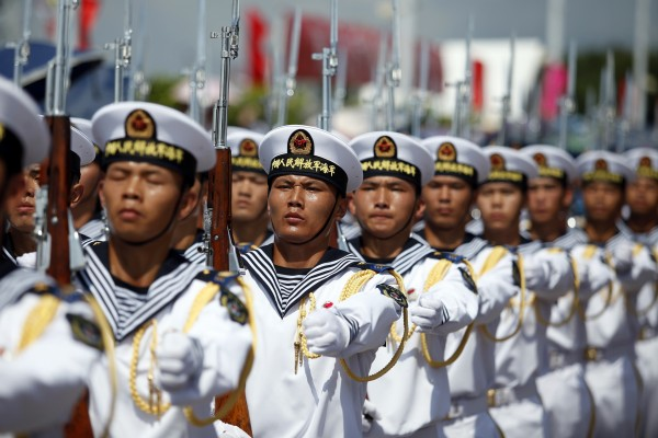 China's Peoples' Liberation Army Navy (PLAN) sailors march at the Ngong Shuen Chau Barracks during Hong Kong's Special Administrative Region Establishment Day holiday on July 1, 2015. Hong Kong Special Administrative Region Establishment Day is celebrated every July 1st in Hong Kong since 1997. AFP PHOTO / ISAAC LAWRENCE (Photo credit should read Isaac Lawrence/AFP/Getty Images)