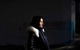 人權律師王全璋的妻子李文足。(FRED DUFOUR/AFP/Getty Images)