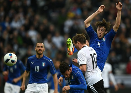 Germany's forward Mario Goetze (2nd R) scores past Italy´s midfielder Alessandro Florenzi (C) and Italy's defender Matteo Darmian (R) during the friendly football match Germany vs Italy in Munich, southern Germany on March 29, 2016. / AFP / PATRIK STOLLARZ (Photo credit should read PATRIK STOLLARZ/AFP/Getty Images)