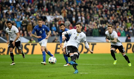 MUNICH, GERMANY - MARCH 29: Mesut Oezil of Germany scores his teams fourth goal from the penalty spot during the International Friendly match between Germany and Italy at Allianz Arena on March 29, 2016 in Munich, Germany. (Photo by Matthias Hangst/Bongarts/Getty Images)