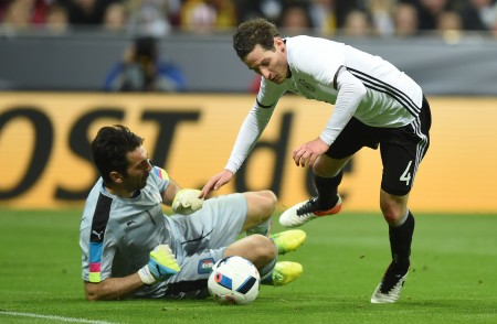 Italian goalkeeper Gianliugi Buffon (L) fouls Germany's defender Sebastian Rudy to give away a penalty during the friendly football match Germany vs Italy in Muinch, southern Germany, on March 29, 2016. / AFP / CHRISTOF STACHE (Photo credit should read CHRISTOF STACHE/AFP/Getty Images)