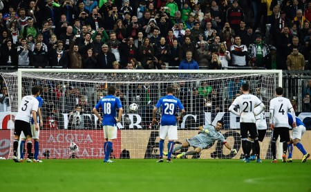 MUNICH, BAVARIA - MARCH 29: Mesut Oezil of Germany scores a penalty goal past Gianluigi Buffon of Italy during the International Friendly match between Germany and Italy at Allianz Arena on March 29, 2016 in Munich, Germany. (Photo by Dennis Grombkowski/Bongarts/Getty Images)