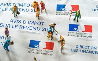 法國總統奧朗德在接受《回聲報》採訪時承諾,如果法國經濟增長率保持上升,將再次為國民減稅。 (PHILIPPE HUGUEN/AFP/Getty Images)