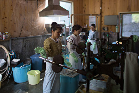 MIYOSHI, JAPAN - APRIL 22: Women work in a small tofu factory, one of the few remaining businesses in her village, on April 22, 2016 in Ochiai, Miyoshi, Japan. Many rural areas of Japan have become heavily depopulated as younger people leave for cities and larger towns in search of work and better prospects. Many of the people who remain are pensioners who, according to Japan's Statistic Bureau, make up 26.8 percent of the population compared to the 8.2 percent average for the rest of the world. (Photo by Carl Court/Getty Images)