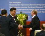 普京6月25日访华,向习近平提前还清6亿多美元的贷款。( Greg Baker-Pool/Getty Images)