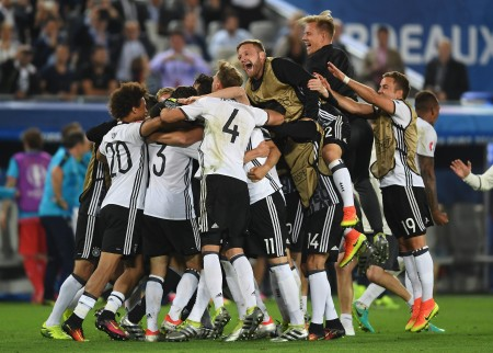 BORDEAUX, FRANCE - JULY 02: Germany players celebrate their win through the penalty shootout during the UEFA EURO 2016 quarter final match between Germany and Italy at Stade Matmut Atlantique on July 2, 2016 in Bordeaux, France. (Photo by Laurence Griffiths/Getty Images)