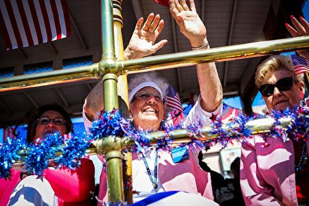 Women on a float wave to the crowds while riding through the 4th of July Parade, in Alameda, California on Monday, July 4, 2016. / AFP / GABRIELLE LURIE (Photo credit should read GABRIELLE LURIE/AFP/Getty Images)