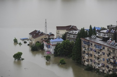This picture taken on July 5, 2016 shows trees and houses submerged by floodwaters in Zongyang county, in east China's Anhui province. Heavy rain around China's Yangtze river basin has left 128 people dead and scores missing, media said on July 5, with more damage feared from a typhoon expected to land this week. / AFP / STR / China OUT (Photo credit should read STR/AFP/Getty Images)
