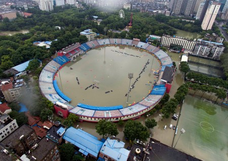 TOPSHOT - This picture taken on July 6, 2016 shows the flooded Xinhua Road Sports Centre Stadium in Wuhan, central China's Hubei province. Heavy rain around China's Yangtze river basin has left 128 people dead and scores missing, media said on July 5, with more damage feared from a typhoon expected to land this week. / AFP / STR / China OUT (Photo credit should read STR/AFP/Getty Images)