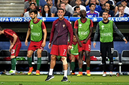 PARIS, FRANCE - JULY 10: Cristiano Ronaldo of Portugal reacts during the UEFA EURO 2016 Final match between Portugal and France at Stade de France on July 10, 2016 in Paris, France. (Photo by Michael Regan/Getty Images)