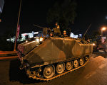 ISTANBUL, TURKEY - JULY 16: Turkish Armys APC's move in the main streets in the early morning hours of July 16, 2016 in Istanbul, Turkey. Istanbul's bridges across the Bosphorus, the strait separating the European and Asian sides of the city, have been closed to traffic. Reports have suggested that a group within Turkey's military have attempted to overthrow the government. Security forces have been called in as Turkey's Prime Minister Binali Yildirim denounced an 'illegal action' by a military 'group', with bridges closed in Istanbul and aircraft flying low over the capital of Ankara (Photo by Defne Karadeniz/Getty Images)